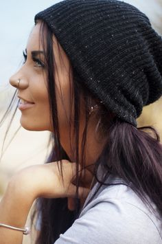 eggplant hair, nose ring, hat, eyes. She's gorgeous love this picture.