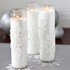 Stop by your local Dollar Tree to purchase white jar candles, rubbing alcohol, thin snowflake ornaments, and glue. To create the enchanting candles, you'll first need to clean the outside of each glass jar well with rubbing alcohol. Once the glass dries, glue a snowflake ornament to the outside of each jar. Light the candles and display them in a cluster to feel like you're in a magical winter wonderland!