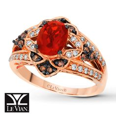 LeVian Fire Opal Ring 1/2 ct tw Diamonds 14K Strawberry Gold  .. this is like the *PIMP MASTER* engagement ring!!! too expensive.. but absolutely gorgeous!!