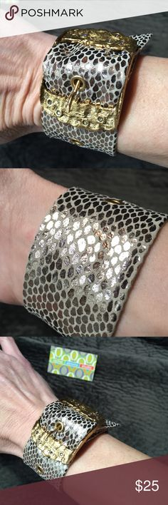 Rachel Abroms Silver Python Buckle Bracelet Fits tight on the wrist. Sold is boutiques and at Nordstroms and Saks Fifth Avenue. This brand has been seen on celebrities and was started by casting agent Rachel Abroms. While her boutique in LA has closed its doors, we have bought her remaining stock and made it available at a fraction of its original cost. Every piece is unique and may have some imperfections in the leather. Made with genuine leather, semi-precious stones and Swarovski…