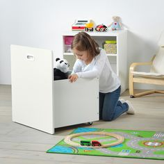 STUVA / FRITIDS Toy storage with wheels, white, white, cm. A spacious toy box on wheels and a shelf for books are hidden behind the front. If you need even more storage, you can also add other frames from the STUVA series. Smart Storage, Toy Storage, Ikea Stuva, Kids Dressers, Honeycomb Paper, Painted Drawers, Ikea Family, Tidy Up, Drawer Fronts
