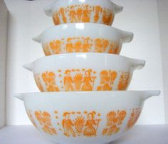 I love vintage pyrex. These orange butterprint cinderella bowls are from etsy seller sassboxclassics.