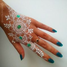 This time handmade art work, not a sticker. White body paint in henna style, not…