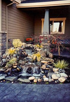Stone waterfall-the perfect thing for the odd corner off the front porch!