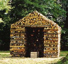 Uber wood stacking. A shed to store cords of wood made from a few cords. #shed #diy #wood