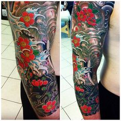 Really cool Elephant half sleeve tattoo implementing the Japanese style really well. Artist: Zachary T. Stuka - Deluxe Tattoo, USA