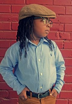 Such a cute kid and the locs are perfect on him!