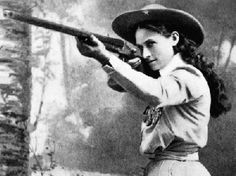Annie Oakley (August 13, 1860 – November 3, 1926) Perhaps Oakley's most famous trick was her ability to repeatedly split a playing card, edge-on, and put several more holes in it before it could touch the ground, while using a .22 caliber rifle, at 90 feet (27 m).