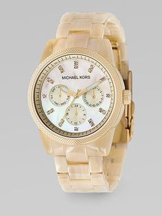 horn acrylic band, swarovski crystals on mother-of-pearl dial watch