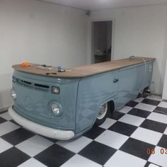 Retro bus on a retro tile floor - love the colors! Shared by www.highroadorganizers.com