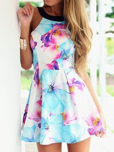 Floral Woman's Sun Dress A beautiful floral print Sun Dress. This sleeveless dress is perfect for any occasion. FREE SHIPPING!! Please allow 1-3 weeks for delivery. Gender: Women Dresses Length: Above
