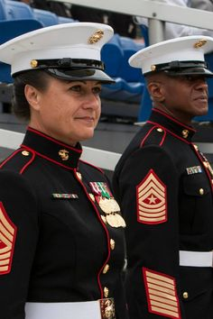 New female Marine covers & coats in testing at 8th & I!    Sgt. Maj. Eric J. Stockton, former Marine Barracks Washington, D.C. sergeant major, right, and Sgt. Maj. Angela M. Maness, the Barracks sergeant major, left, stand side-by-side during a relief and appointment ceremony at the Barracks June 27. Maness assumed her post after relieving Stockton. Stockton retired during the ceremony after more than 30 years of service. (Official Marine Corps photo by Sgt. Dengrier M. Baez/Released)