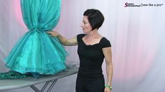 When rhinestoning Dancesport Ballgowns (or working on other parts of the dress), it's wise to loosely tie skirt up near the base so the full skirt is out of your way and less likely to be damaged.