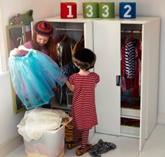 "Girls playing ""dressing-up"" with clothes that hangs in STUVA storage combination with doors"