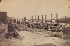 "The seemingly endless array of steamships along the wharf at Nashville, Tennessee, provides an accurate report of the complex preparations required to supply the United States Army before an impending Civil War engagement-in this case the battle of Murfreesboro on December 28, 1862. The square containers in the foreground are clearly stenciled ""Pilot bread from the U.S. Government Bakery."