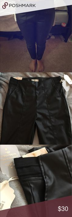 "Altar'd State ""Leather"" Pants Purchased on sale from Altar'd State and have never worn because they come up a little high on my ankles. They are 38"" from waist to bottom of leg. There is elastic next to pockets on both sides as pictured for a comfy fit. They have a slight hint of that new ""pleather"" smell, that I'm sure could be washed out but they are new from the bag they were shipped in and have left them as such. Altar'd State Jeans Skinny"