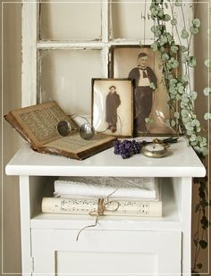 vintage photos, specs, window, and dried flowers