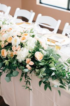Head table floral decor with five feet of lush white hydrangea, White O'Hara and Juliet David Austin garden roses and pale peach spray roses mixed with italian ruscus and plumosa fern. Flowers by Janie- Calgary Wedding at Sirocco Golf Club www.flowersbyjanie.com Photo: @heartsparrow