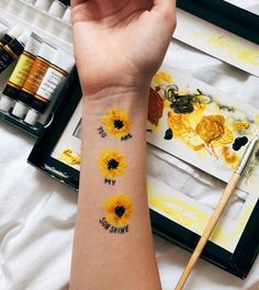 Painting yellow flowers on her arm. #arthoe #aesthetic #tumblr #artsy