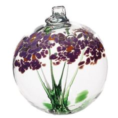 """Kitras Art Glass still honors the old world tradition of glass blowing with studios in Canada. The 2"""" Blossom Ball ornament is typical of their design, featuring an inside stem blossoming onto the top"""