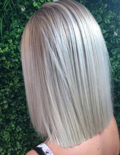 Try a straight blunt chop that will take you from regular to runway in a second! #ashblonde #hairstyle #blondehair #haircolor