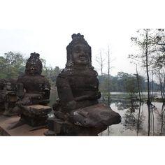 Statutes stand guard along the rive banks, Cambodia Cambodia, Statue Of Liberty, Buddha, Photography, Travel, Liberty Statue, Fotografie, Photograph, Viajes