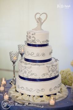 Buttercream wedding cake with silver piped detail and cobalt blue ribbon accents