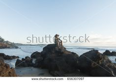 Woman contemplating the sunrise on Cotovelo beach.in Natal, RN, Brazil