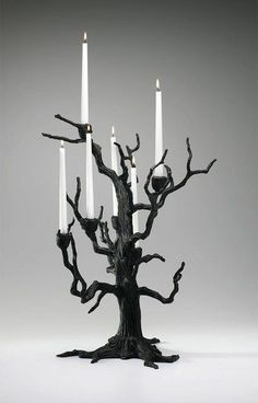 When you live your life at night, candles are essential! I love the branches of this tree candelabra.