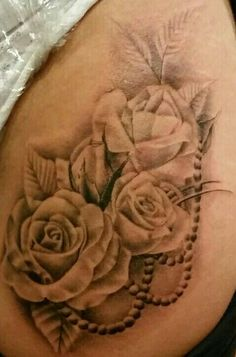 My newest tattoo. Roses with pearls