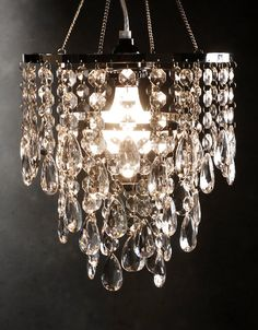 Add a touch of class with this three tier acrylic crystal chandelier. The chandelier includes a cord kit and all the hanging hardware. A great accent piece. Measures high including hanging chain) x wide. The light cord is 12 feet long, h Closet Lighting, Home Lighting, Bathroom Lighting, Event Lighting, Luxury Lighting, Interior Lighting, Lighting Ideas, Crystal Chandelier Lighting, Chandelier Lamp