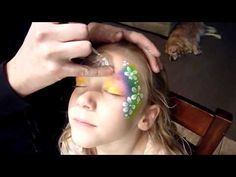 """Very easy and fast rainbow flower face painting.  I usually describe this design to the kids as a """"Flower Fairy Princess.""""  Extremely fast and always a crowd pleaser!    In the video I called this a full face design, but it's more of a mask.    Products used:  Diamond FX Rainbow Cake  Diamond FX White  Silly Farm Glitter  Number 6 Loew Cornell B..."""