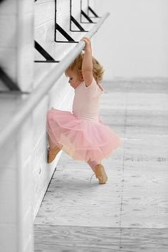 Cute kids: little pink ballerina in a ballet tutu.