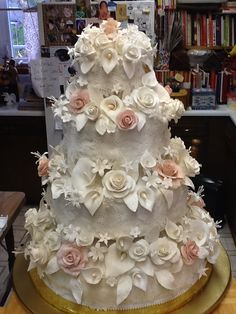 Gum paste flowers and lace wedding cake.