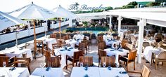 EAT: at The Bungalow in Clifton, Cape Town. Cotton and Ice. Sand and sequins. Beautiful, bronzed and a little bit blasphemous - it's the Bungalow.   Take balmy add a splash of bubbly stir in a breezy blonde pop in an oyster and it's the Bungalow. Bungalicious if you will.http://www.thebungalow.co.za/