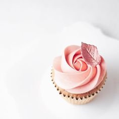 Strawberries & Champagne cupcake with Madagascan vanilla buttercream piped In a pretty rose and finished with a rose gold leaf!