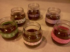 Chocolate Facial in baby food jars with ribbon attached by hot glue gun.