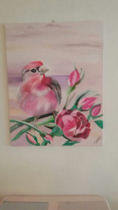 Een roze pimpelmees op een  bloesemtak