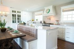 This unique shaped backsplash is balanced by its neutral color, giving this kitchen the traditional feel we wanted to achieve.