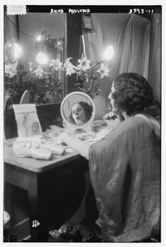 Anna Pavlova in her dressing room. Pavolova (1881-1931) was a Russian ballerina of the late 19th and the early 20th century. She is widely regarded as one of the finest classical ballet dancers in history and was most noted as a principal artist of the Imperial Russian Ballet and the Ballets Russes of Sergei Diaghilev. Pavlova is most recognised for the creation of the role The Dying Swan and, with her own company, became the first ballerina to tour ballet around the world.