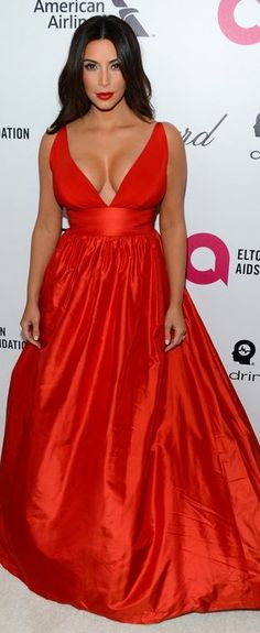 kim kardashian  Who made  Kim Kardashians jewelry and red gown that she wore in West Hollywood on March 2, 2014?