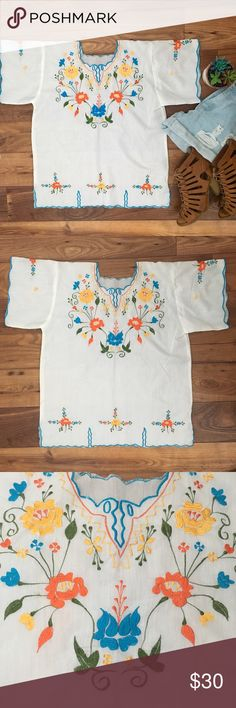 "Mexican embroidered top Hand made so it doesn't have a size tag. I would say it best fits a medium or large. Measurements: 20"" chest 17"" shoulder seam to seam 20"" length shoulder to bottom. Material does not have stretch. Semi sheer best worn with a cute bralette or cami underneath. On trend for summer casual and cute! Remember to bundle and save or make me an offer I accept most offers! Tops"