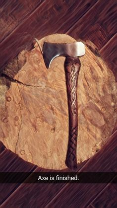 Restored axe with carved handle.