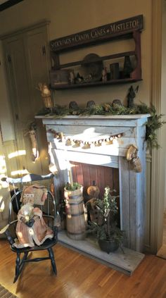 love the wood hearth and red background in the opening Primitive Mantels, Primitive Fireplace, Faux Fireplace, Fireplace Surrounds, Fireplace Ideas, Primitive Decor, Mantle Ideas, Prim Decor, Country Decor