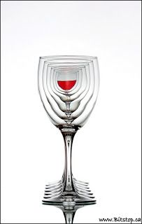 Bitstop: Glass Still Life.  Creative image of wine glasses in a row with a spot of red wine.