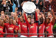 Manchester United's players celebrate with the Community Shield after beating Leicester 2-1 at Wembley Stadium