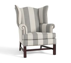 Two of these in the sunroom....Thatcher Upholstered Wingback Chair | Pottery Barn