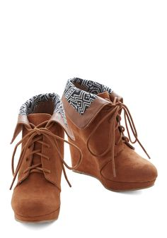 Telluride a Story Bootie in Cinnamon. Have you heard the one about the girl making a statement in a Colorado resort town simply by stepping out in these cognac wedged booties? #brown #modcloth