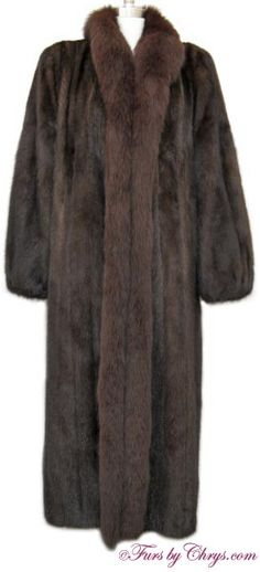 SOLD! Mahogany Mink and Brown Fox Fur Coat #MMF720; Very Good Condition; 10 - 14. This is an elegant genuine natural mahogany mink and dyed brown fox fur coat in a luxuriously long length. It features a full brown fox tuxedo collar, very lightly elasticized sleeve ends and lightly padded shoulders. The mink fur is very soft and silky, and the fox fur is very full and fluffy! This mahogany mink coat is both understated and yet dazzling all at once!