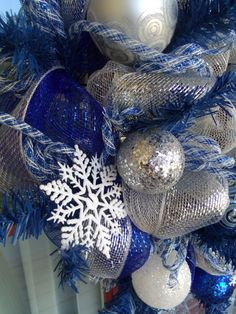 Blue,White, And Silver Snowflake Deco Mesh Christmas Wreath via Etsy.